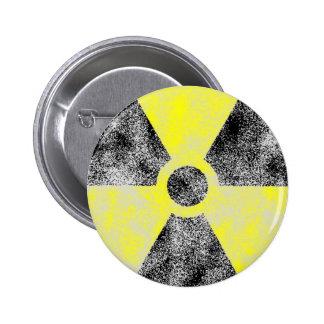 Polvillo radiactivo pins