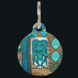 "Pomaika'i Tiki Hawaiian Vintage Tapa Pet Name Tag<br><div class=""desc"">Teal, turq, aqua, cocoa and natural colorway. It is &quot;good fortune&quot; to have the Tiki God Ku protect you. We have surrounded him with pineapples, tribal staffs, graphic flowers and tapa elements in this whimsical design that is reminiscent of the Aloha shirt designs of the forties and fifties. There are...</div>"