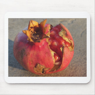 Pomegranate fruit with visible grains . Shooted at Mouse Pad