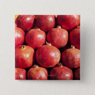 Pomegranates on display at the Carmel Market Button