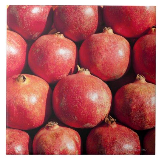 Pomegranates on display at the Carmel Market Tile