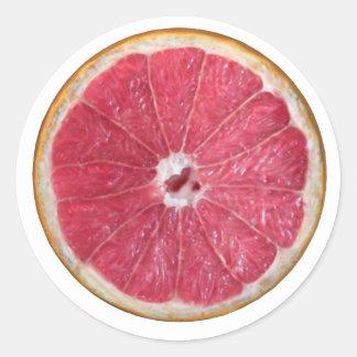 Pomelo rojo jugoso etiqueta redonda