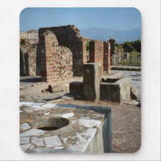 Pompeya, ranuras de medición para el grano y las alfombrilla de ratón