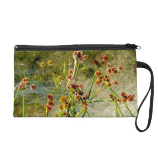 Pond shore plants, spiked puffs on stems photo wristlet purses