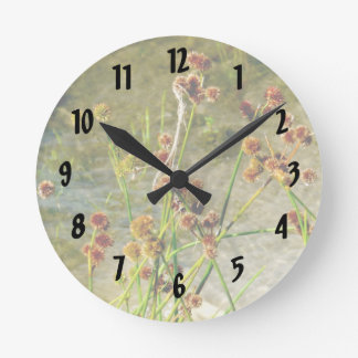 Pond shore plants, spiked puffs on stems photo round wall clock