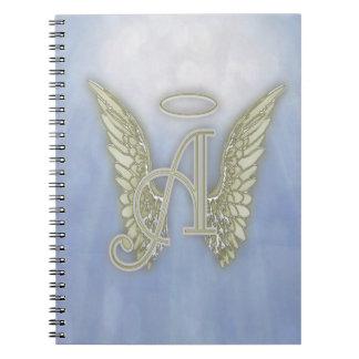 Ponga letras a un monograma del ángel libros de apuntes