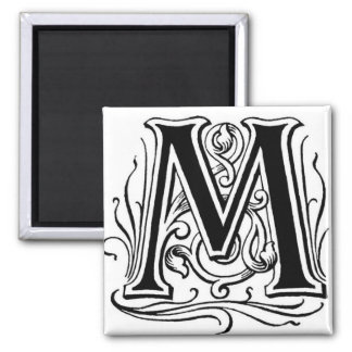 Ponga letras al ` M' en el negro - imán