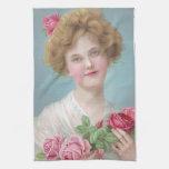Ponga los rosas en sus mejillas toallas