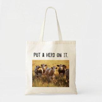 Ponga una manada en él bolsa tela barata