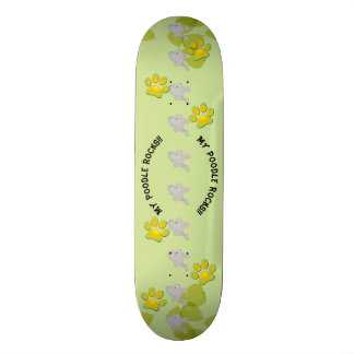 Poodle on Green Leaves with green pawprints Skateboard Deck