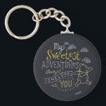 "Pooh | My Sweetest Adventures Keychain<br><div class=""desc"">Winnie the Pooh skipping under the clouds with the cute saying &quot;My sweetest adventures always include you.&quot;</div>"