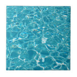 """Pool Ceramic Tile<br><div class=""""desc"""">Light glistens off moving water in a swimming pool.  Results in a beautiful aqua abstract pattern.</div>"""