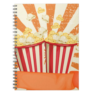 Popcorn in cups with banner spiral notebook