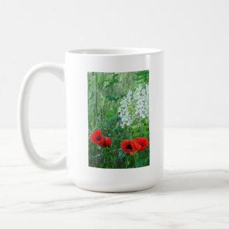 Poppies and acacia flowers coffee mug