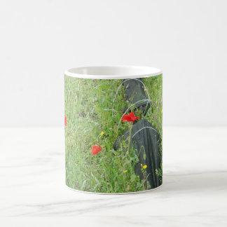 Poppies overgrowing on allotment coffee mug