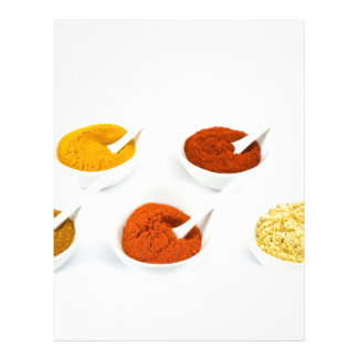 Porcelain bowls and spoons with various spices letterhead