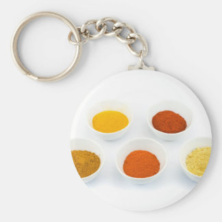 Porcelain bowls with several seasoning spices keychain