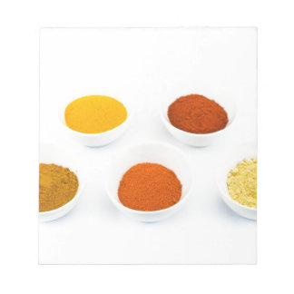 Porcelain bowls with several seasoning spices notepad