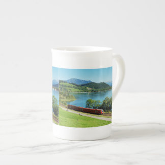 Porcelain cup of large Alpsee with Immenstadt