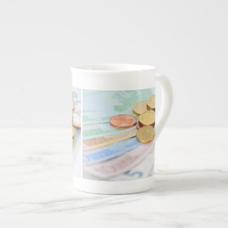 Porcelain cup with euro motive for currency
