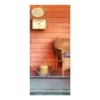 Porch With Brass Watering Can Rack Card