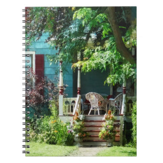 Porch With Flowerpots and Wicker Chairs Note Books