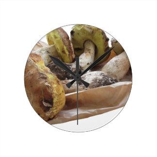 Porcini mushrooms isolated on white background round clock