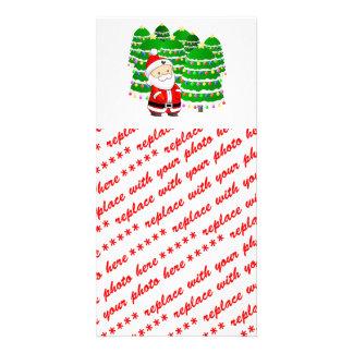 Porción de Papá Noel y del árbol de navidad Tarjeta Fotografica