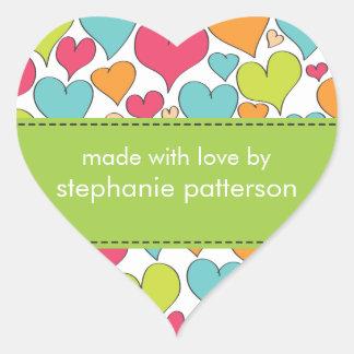 Porciones de corazones hechos con amor por el pegatina en forma de corazón