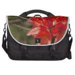 Porciones de flores rojas bolsas para portatil