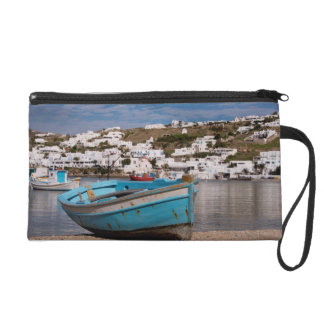 Port and harbor area with Greek fishing boats Wristlet Purse
