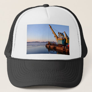 Port Themed, A Crane Situated At The Dock Of A Par Trucker Hat