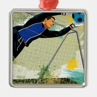 Portero del fútbol que bloquea la bola adorno navideño cuadrado de metal