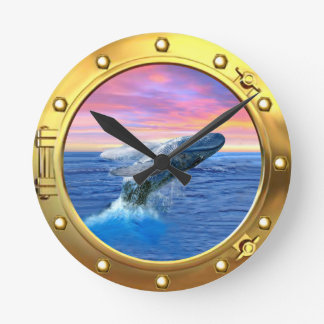 Porthole View of a Breaching Whale Round Clock