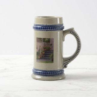 Pórtico con las regaderas tazas de café