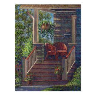 Pórtico con las sillas de mimbre rojas postales