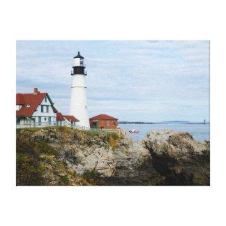 Portland Headlight lighthouse on rocky shore Canvas Print