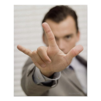Portrait of a businessman making a hand sign