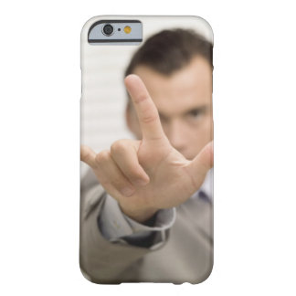Portrait of a businessman making a hand sign barely there iPhone 6 case