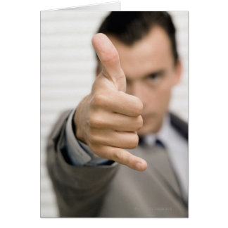 Portrait of a businessman making a thumbs up card