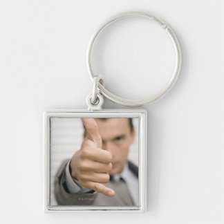 Portrait of a businessman making a thumbs up keychain