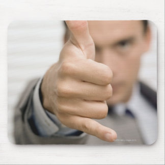 Portrait of a businessman making a thumbs up mouse pad