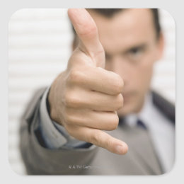 Portrait of a businessman making a thumbs up square sticker