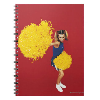Portrait of a Cheerleader Holding Pom-poms Spiral Notebook