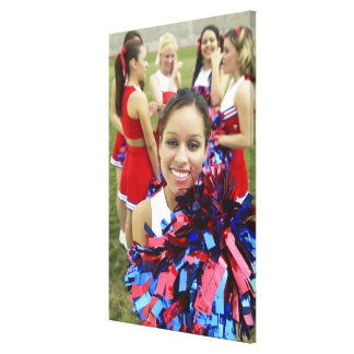 Portrait of a Cheerleader in Front of a Group of Canvas Print