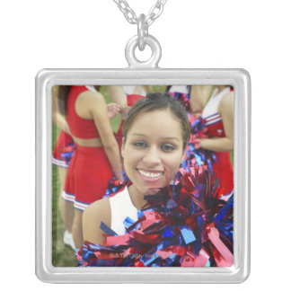 Portrait of a Cheerleader in Front of a Group of Silver Plated Necklace