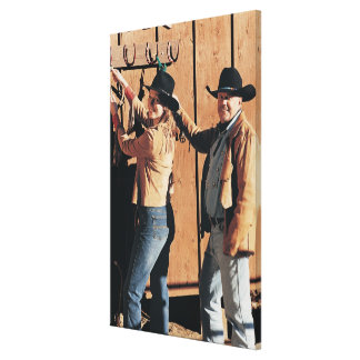 Portrait of a Cowboy and Cowgirl Arranging Reins Canvas Print