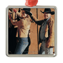 Portrait of a Cowboy and Cowgirl Arranging Reins Metal Ornament