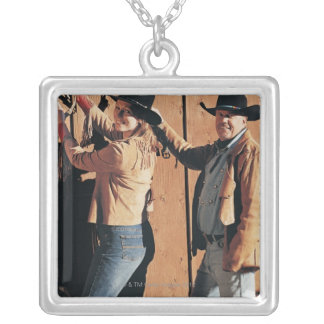 Portrait of a Cowboy and Cowgirl Arranging Reins Square Pendant Necklace