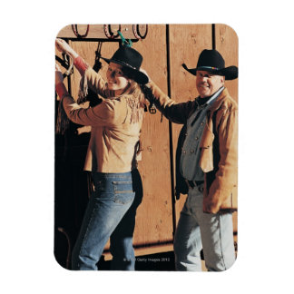 Portrait of a Cowboy and Cowgirl Arranging Reins Magnets